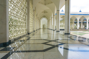 Shining floor marble reflection at mosque corridor