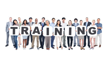 Group of Business People Holding Word Training