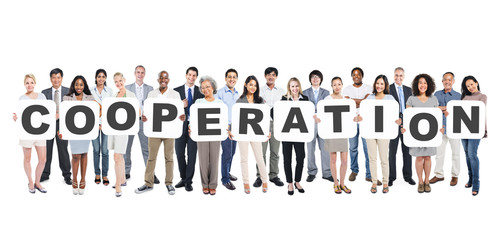 Group Of Diverse People Holding Word Cooperation