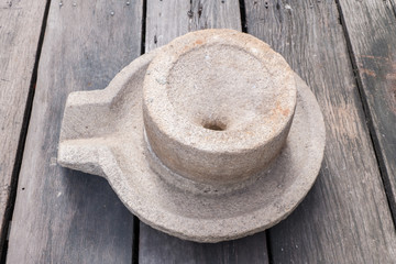 millstone on wood floor