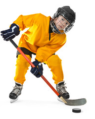 Young hockey player with stick and puck