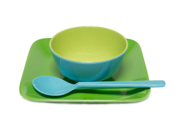 Melamine blue bowl and green dish on white background