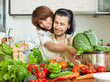 Attractive couple preparing vegetable salad