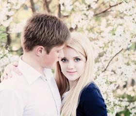 portrait of young couple in spring gadren