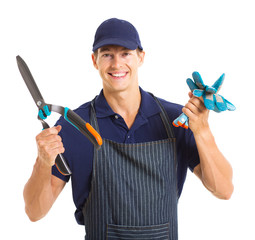 gardener holding gloves and garden shears