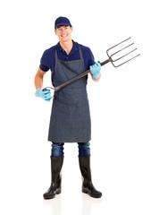 farmer holding a garden fork