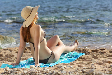 Woman sunbathing on the beach in summer