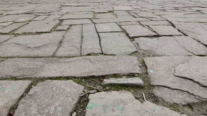 Dolly: Ancient cobblestone pavement in old town