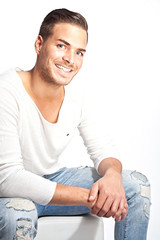 Portrait of a beautiful young smiling man against white backgrou