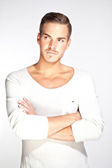 Portrait of a beautiful young man with white background