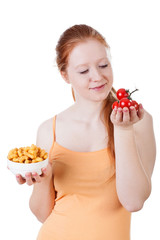 Girl holding chips and tomatoes