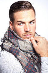 Portrait of a beautiful young man with scarf