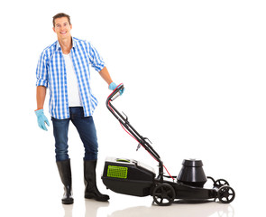 man standing next to an electric lawnmower