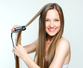woman styling her long natural hair. straight hair.
