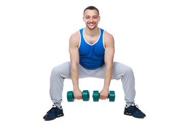 Sport man working out with dumbbells over white bakground