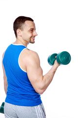 happy sport man doing exercises with dumbbells