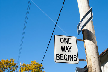 One way begins street sign