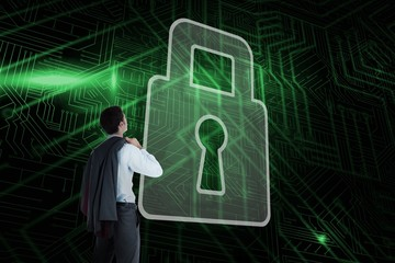 Composite image of lock and businessman looking