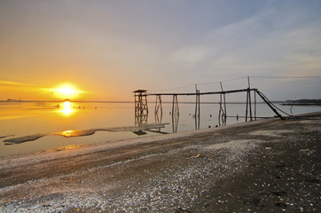 old abandoned fisherman jetty during sunset
