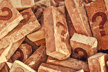 Pile of bricks with question marks