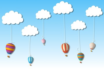 Hot air balloons hanging from clouds