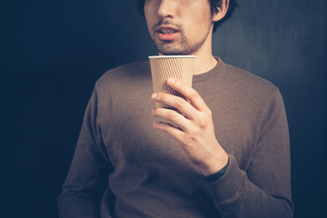 Young man with a paper cup