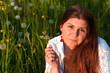 canvas print picture - junge Frau auf der Blumenwiese