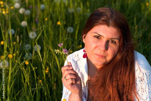 canvas print picture junge Frau auf der Blumenwiese