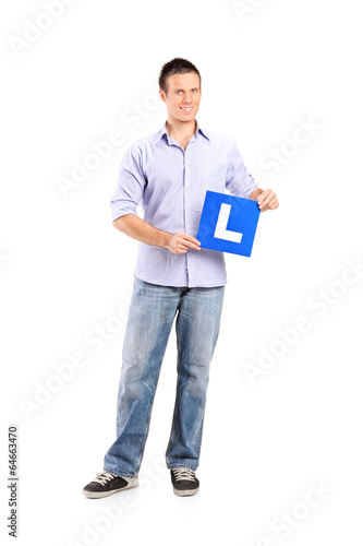 Young man holding an l sign