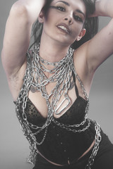 Model, Beautiful brunette woman with big silver chains chained
