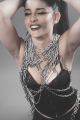 Fetish, Beautiful brunette woman with big silver chains chained