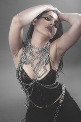 Slave, Beautiful brunette woman with big silver chains chained