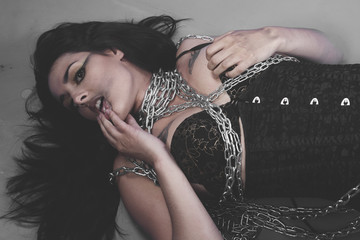 Sadomasochistic, Beautiful brunette woman with big silver chains