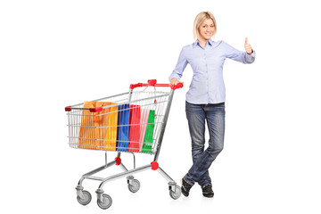 Woman with shopping cart giving thumb up