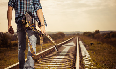 guitarist on a road to horizon