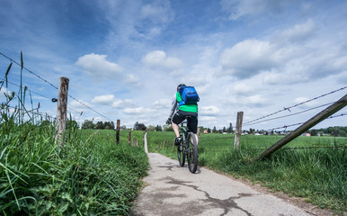 Mountainbiker on a country lane