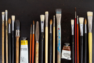 Paintbrushes on dark background