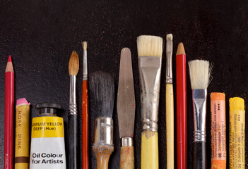 Diversity of art supplies in a row
