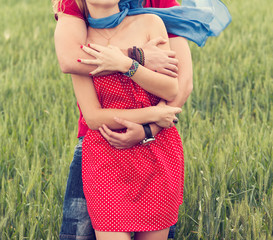 Couple hugging in a green land