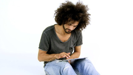 Man reading tablet relaxing isolated