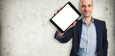 Smiling man holding a tablet with blank screen