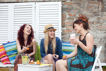 Cheerful women in outdoor cafe