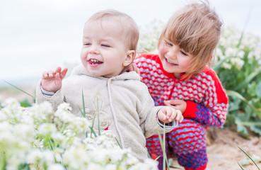 happy children with wildflowers