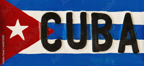 Fotobehang Centraal-Amerika Landen Red-blue-white Cuban flag on metal plate, Cuba, Republic of Cuba
