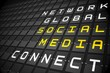Social media buzzwords on black mechanical board