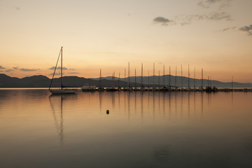Yacht sailing against sunset. Holiday lifestyle landscape with s