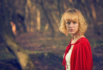 blond woman portrait in red cape