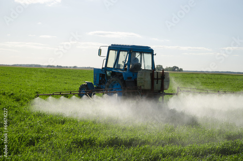 Tractor fertilize field pesticide and insecticide - 64674227