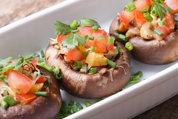 Portobello mushrooms stuffed with vegetables and cheese