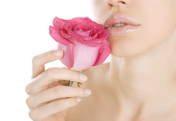 Beauty woman holding pink rose on white, Close-up isolated